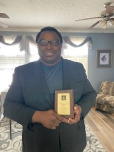 Dr. Femi Obasun Receives the Prestigious Distinguished Scholar Award